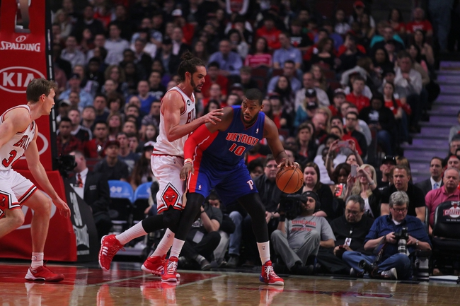 Apr 11, 2014; Chicago, IL, USA; Detroit Pistons forward Greg Monroe (10) is defended by Chicago Bulls center Joakim Noah (13) during the first quarter at the United Center. Mandatory Credit: Dennis Wierzbicki-USA TODAY Sports