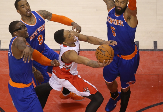 Apr 11, 2014; Toronto, Ontario, CAN; Toronto Raptors guard DeMar DeRozan (10) is fouled by New York Knicks forward Amar'e Stoudemire (1) on his way to the basket at Air Canada Centre. Mandatory Credit: Tom Szczerbowski-USA TODAY Sports