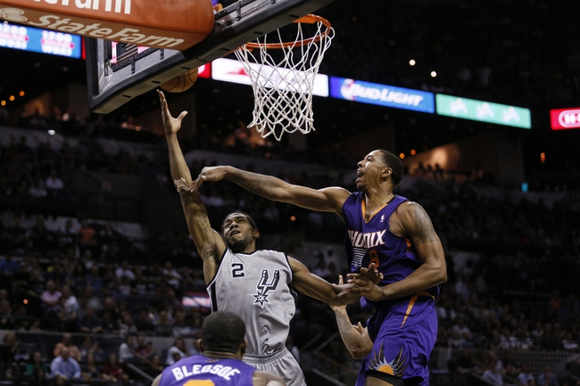 Apr 11, 2014; San Antonio, TX, USA; San Antonio Spurs forward Kawhi Leonard (2) shoots as Phoenix Suns forward Channing Frye (8) defends during the first half at AT&T Center. Mandatory Credit: Soobum Im-USA TODAY Sports