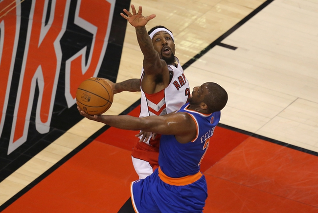 Apr 11, 2014; Toronto, Ontario, CAN; New York Knicks point guard Raymond Felton (2) goes to the basket and scores pasr Toronto Raptors forward John Salmons (25) at Air Canada Centre. Mandatory Credit: Tom Szczerbowski-USA TODAY Sports