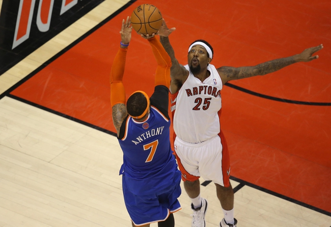 Apr 11, 2014; Toronto, Ontario, CAN; New York Knicks forward Carmelo Anthony (7) shoots and scores a basket over Toronto Raptors forward John Salmons (25) at Air Canada Centre. Mandatory Credit: Tom Szczerbowski-USA TODAY Sports