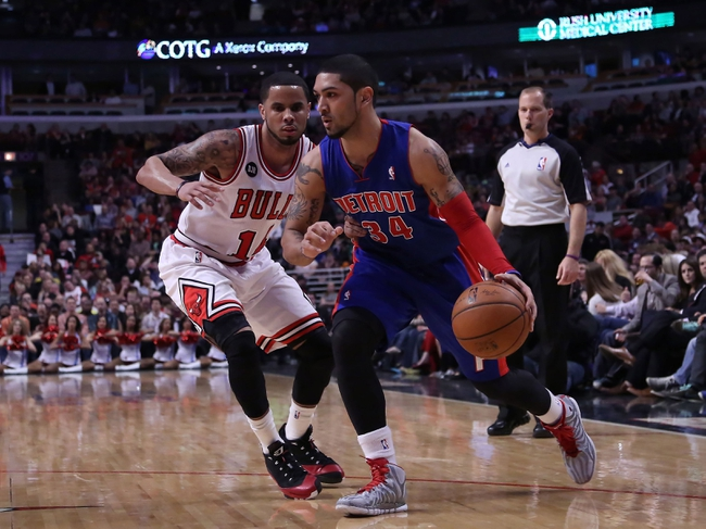 Apr 11, 2014; Chicago, IL, USA; Detroit Pistons guard Peyton Siva (34) drives past Chicago Bulls guard D.J. Augustin (14) during the second quarter at the United Center. Mandatory Credit: Dennis Wierzbicki-USA TODAY Sports