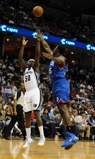 Apr 11, 2014; Memphis, TN, USA; Memphis Grizzlies forward Zach Randolph (50) shoots against Philadelphia 76ers center Henry Sims (35) during the game at FedExForum. Mandatory Credit: Justin Ford-USA TODAY Sports