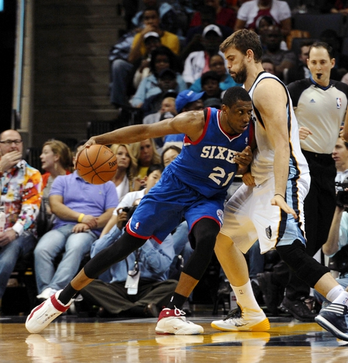 Apr 11, 2014; Memphis, TN, USA; Philadelphia 76ers forward Thaddeus Young (21) drives to the basket against Memphis Grizzlies center Marc Gasol (33) during the game at FedExForum. Mandatory Credit: Justin Ford-USA TODAY Sports