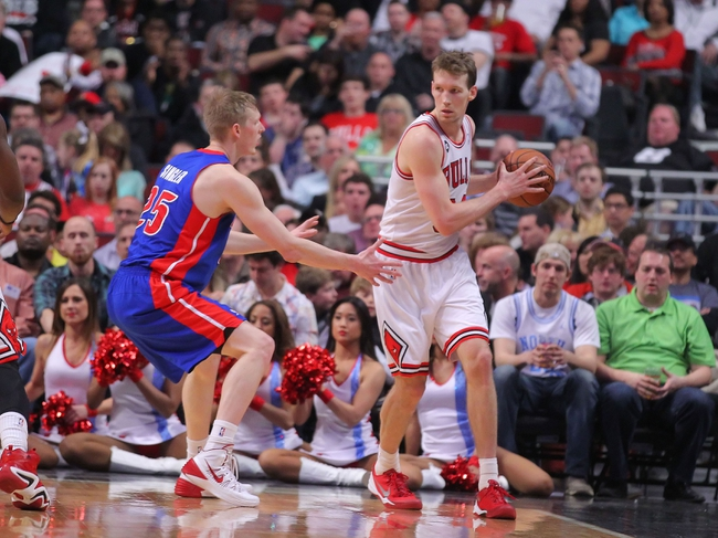 Apr 11, 2014; Chicago, IL, USA; Chicago Bulls forward Mike Dunleavy (34) is defended by Detroit Pistons forward Kyle Singler (25) during the second quarter at the United Center. Mandatory Credit: Dennis Wierzbicki-USA TODAY Sports