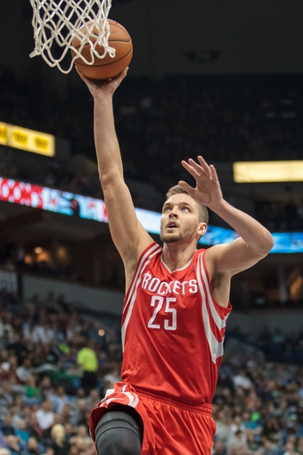 Apr 11, 2014; Minneapolis, MN, USA; Houston Rockets forward Chandler Parsons (25) dunks in the second quarter against the Minnesota Timberwolves at Target Center. Mandatory Credit: Brad Rempel-USA TODAY Sports