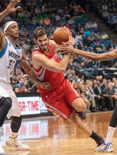Apr 11, 2014; Minneapolis, MN, USA; Houston Rockets forward Omri Casspi (18) is fouled in the second quarter against the Minnesota Timberwolves at Target Center. Mandatory Credit: Brad Rempel-USA TODAY Sports