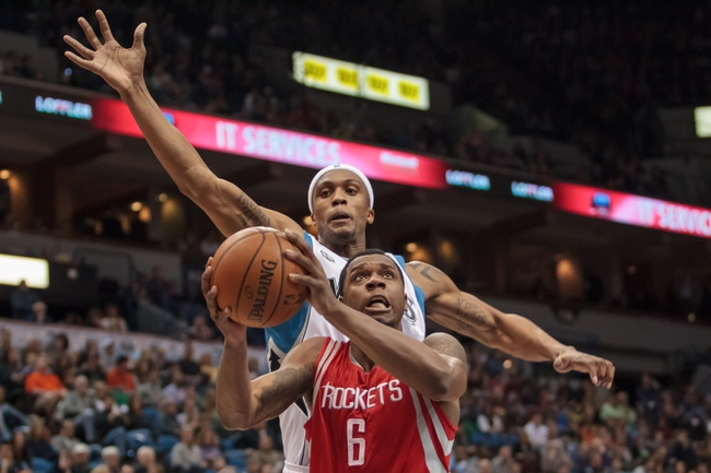Apr 11, 2014; Minneapolis, MN, USA; Minnesota Timberwolves forward Dante Cunningham (33) attempts to block Houston Rockets forward Terrence Jones (6) in the second quarter at Target Center. Mandatory Credit: Brad Rempel-USA TODAY Sports