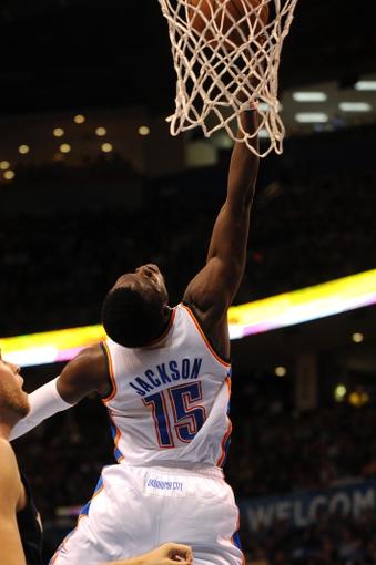 Apr 11, 2014; Oklahoma City, OK, USA; Oklahoma City Thunder guard Reggie Jackson (15) attempts a reverse layup against the New Orleans Pelicans during the second quarter  at Chesapeake Energy Arena. Mandatory Credit: Mark D. Smith-USA TODAY Sports