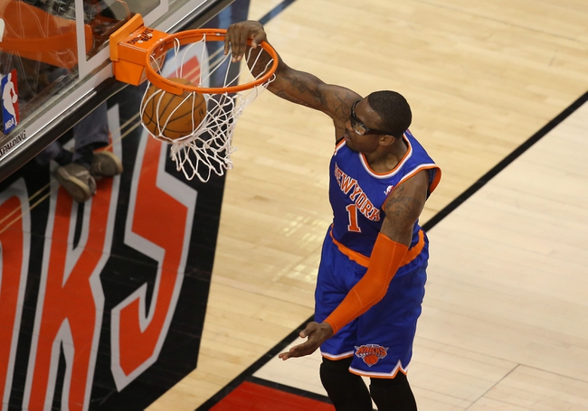 Apr 11, 2014; Toronto, Ontario, CAN; New York Knicks forward Amar'e Stoudemire (1) dunks against the Toronto Raptors at Air Canada Centre. Mandatory Credit: Tom Szczerbowski-USA TODAY Sports