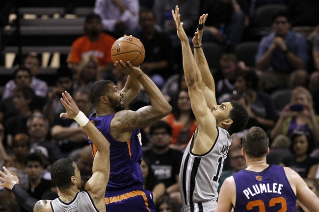 Apr 11, 2014; San Antonio, TX, USA; Phoenix Suns  forward Markieff Morris (11) shoots the ball over San Antonio Spurs forward Jeff Ayres (11) during the first half at AT&T Center. Mandatory Credit: Soobum Im-USA TODAY Sports