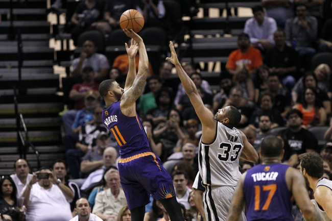 Apr 11, 2014; San Antonio, TX, USA; Phoenix Suns forward Markieff Morris (11) shoots the ball over San Antonio Spurs forward Boris Diaw (33) during the first half at AT&T Center. Mandatory Credit: Soobum Im-USA TODAY Sports