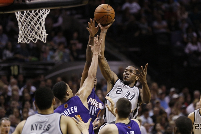 Apr 11, 2014; San Antonio, TX, USA; San Antonio Spurs forward Kawhi Leonard (2) shoots the ball over Phoenix Suns  guard Gerald Green (14) during the first half at AT&T Center. Mandatory Credit: Soobum Im-USA TODAY Sports