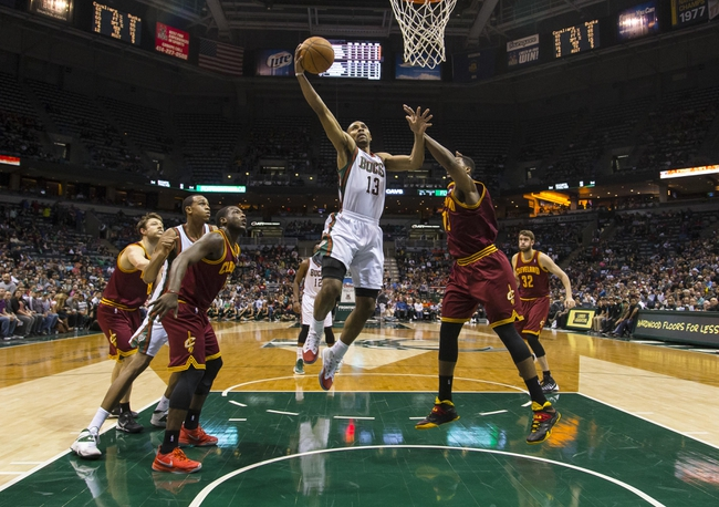 Apr 11, 2014; Milwaukee, WI, USA; Milwaukee Bucks guard Ramon Sessions (13) shoots during the second quarter against the Cleveland Cavaliers at BMO Harris Bradley Center. Mandatory Credit: Jeff Hanisch-USA TODAY Sports
