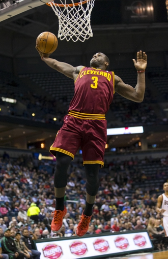 Apr 11, 2014; Milwaukee, WI, USA; Cleveland Cavaliers guard Dion Waiters (3) dunks during the second quarter against the Milwaukee Bucks at BMO Harris Bradley Center. Mandatory Credit: Jeff Hanisch-USA TODAY Sports