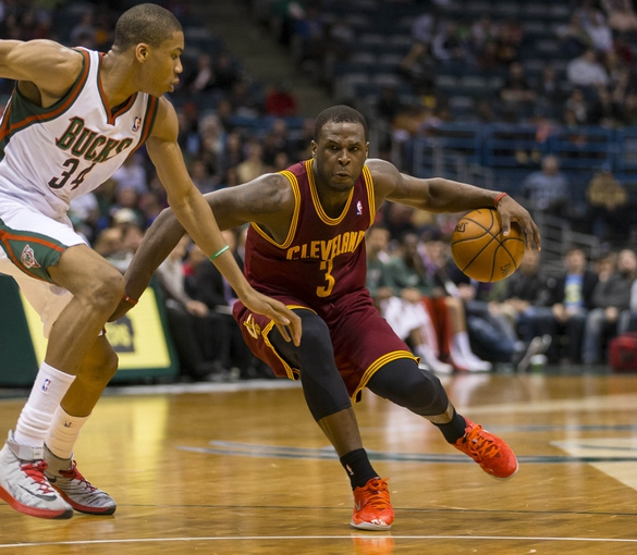 Apr 11, 2014; Milwaukee, WI, USA; Cleveland Cavaliers guard Dion Waiters (3) drives for the basket as Milwaukee Bucks guard Giannis Antetokounmpo (34) defends during the second quarter at BMO Harris Bradley Center. Mandatory Credit: Jeff Hanisch-USA TODAY Sports