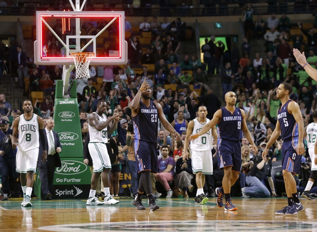 Apr 11, 2014; Boston, MA, USA; Charlotte Bobcats center Al Jefferson (25) reacts after the buzzer ends the game against the Boston Celtics at TD Garden. The Celtics defeated the Bobcats 106-103. Mandatory Credit: David Butler II-USA TODAY Sports