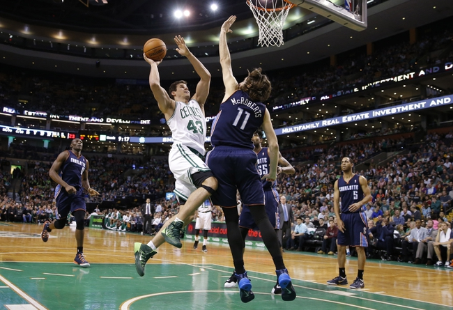 Apr 11, 2014; Boston, MA, USA; Boston Celtics center Kris Humphries (43) drives the ball against Charlotte Bobcats forward Josh McRoberts (11) in the second half at TD Garden. The Celtics defeated the Bobcats 106-103. Mandatory Credit: David Butler II-USA TODAY Sports
