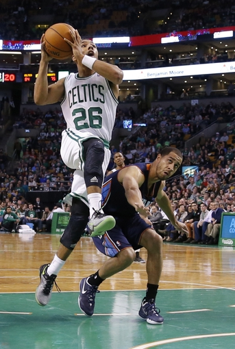 Apr 11, 2014; Boston, MA, USA; Boston Celtics guard Phil Pressey (26) drives the ball against Charlotte Bobcats guard Jannero Pargo (5) in the second half at TD Garden. The Celtics defeated the Bobcats 106-103. Mandatory Credit: David Butler II-USA TODAY Sports