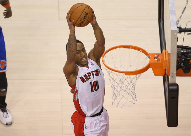 Apr 11, 2014; Toronto, Ontario, CAN; Toronto Raptors guard DeMar DeRozan (10) dunks against the New York Knicks at Air Canada Centre. The Knicks beat the Raptors 108-100. Mandatory Credit: Tom Szczerbowski-USA TODAY Sports