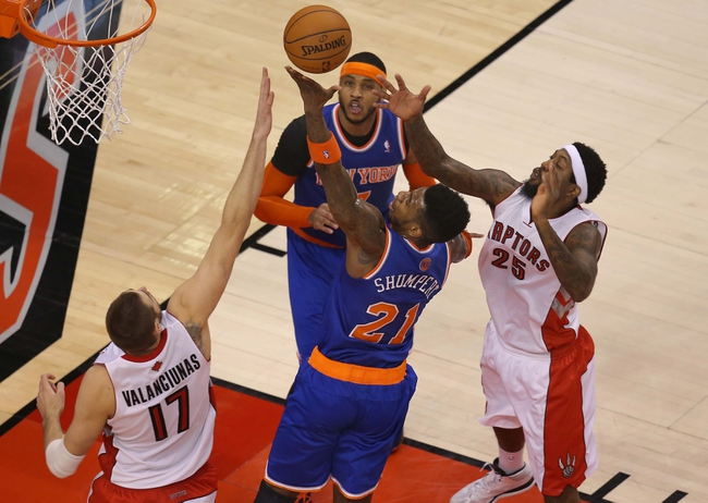 Apr 11, 2014; Toronto, Ontario, CAN; New York Knicks forward Iman Shumpert (21) goes to the basket and scores against the Toronto Raptors at Air Canada Centre. The Knicks beat the Raptors 108-100. Mandatory Credit: Tom Szczerbowski-USA TODAY Sports