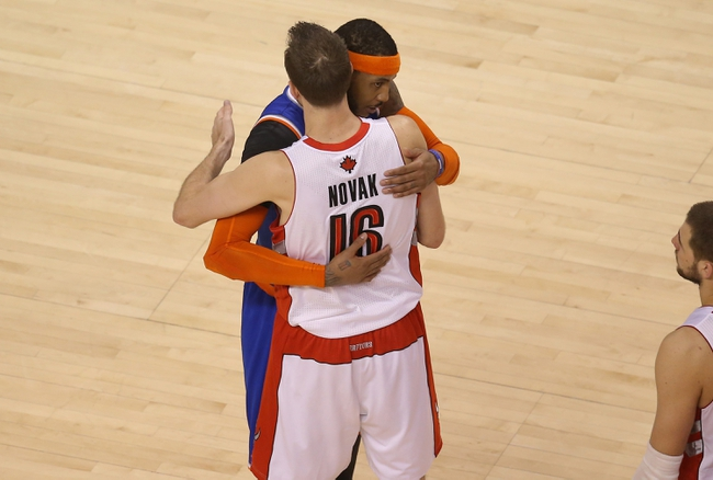 Apr 11, 2014; Toronto, Ontario, CAN; New York Knicks forward Carmelo Anthony (7) is congratulated by former teammate and Toronto Raptors forward Steve Novak (16) at Air Canada Centre. The Knicks beat the Raptors 108-100. Mandatory Credit: Tom Szczerbowski-USA TODAY Sports