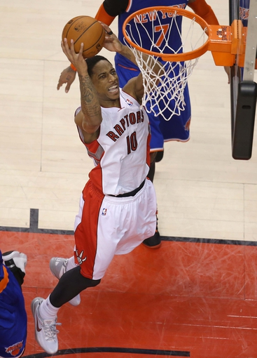Apr 11, 2014; Toronto, Ontario, CAN; Toronto Raptors guard DeMar DeRozan (10) goes to the basket against the New York Knicks at Air Canada Centre. The Knicks beat the Raptors 108-100. Mandatory Credit: Tom Szczerbowski-USA TODAY Sports