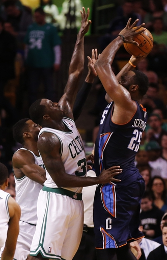 Apr 11, 2014; Boston, MA, USA; Boston Celtics forward Brandon Bass (30) and forward Jeff Green (8) defend against Charlotte Bobcats center Al Jefferson (25) in the second half at TD Garden. The Celtics defeated the Bobcats 106-103. Mandatory Credit: David Butler II-USA TODAY Sports