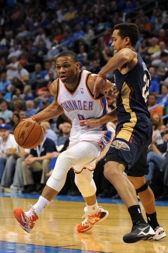 Apr 11, 2014; Oklahoma City, OK, USA;  Oklahoma City Thunder guard Russell Westbrook (0) drives to the basket against New Orleans Pelicans guard Brian Roberts (22) during the second quarter at Chesapeake Energy Arena. Mandatory Credit: Mark D. Smith-USA TODAY Sports