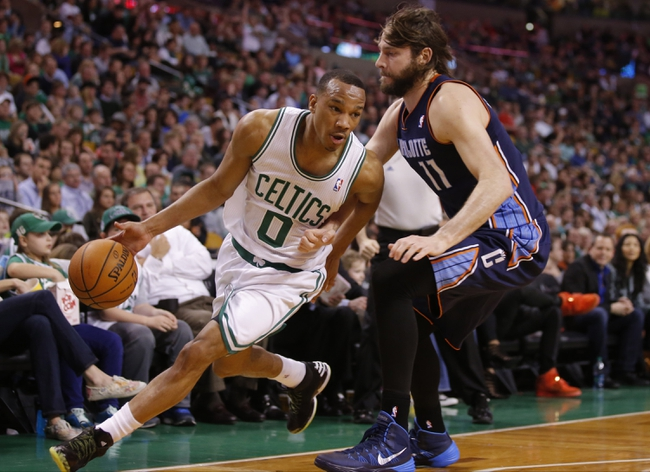 Apr 11, 2014; Boston, MA, USA; Boston Celtics guard Avery Bradley (0) drives the ball against Charlotte Bobcats forward Josh McRoberts (11) in the second half at TD Garden. The Celtics defeated the Bobcats 106-103. Mandatory Credit: David Butler II-USA TODAY Sports