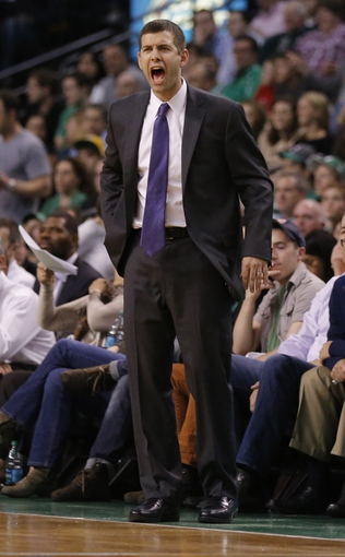Apr 11, 2014; Boston, MA, USA; Boston Celtics head coach Brad Stevens watches from the sideline as they take on the Charlotte Bobcats in the second half at TD Garden. The Celtics defeated the Bobcats 106-103. Mandatory Credit: David Butler II-USA TODAY Sports
