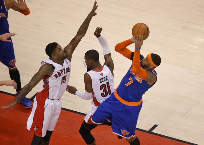 Apr 11, 2014; Toronto, Ontario, CAN; New York Knicks forward Carmelo Anthony (7) shoots against Toronto Raptors forward Amir Johnson (15) at Air Canada Centre. The Knicks beat the Raptors 108-100. Mandatory Credit: Tom Szczerbowski-USA TODAY Sports