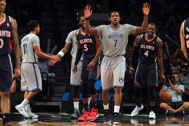 Apr 11, 2014; Brooklyn, NY, USA; Brooklyn Nets shooting guard Joe Johnson (7) reacts during the fourth quarter of a game against the Atlanta Hawks at Barclays Center. The Hawks defeated the Nets 93-88. Mandatory Credit: Brad Penner-USA TODAY Sports