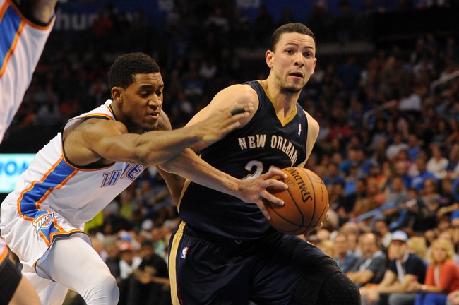 Apr 11, 2014; Oklahoma City, OK, USA;  New Orleans Pelicans guard Austin Rivers (25) drives to the basket against tOklahoma City Thunder forward Perry Jones (3) during the fourth quarter at Chesapeake Energy Arena. Mandatory Credit: Mark D. Smith-USA TODAY Sports
