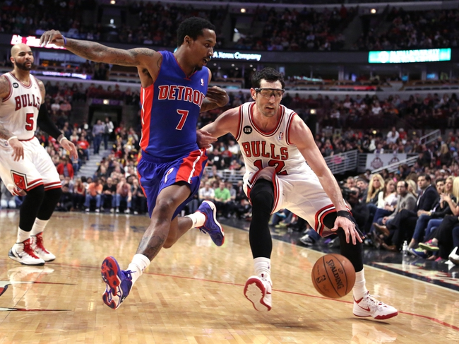 Apr 11, 2014; Chicago, IL, USA; Chicago Bulls guard Kirk Hinrich (12) drives past Detroit Pistons guard Brandon Jennings (7) during the second half at the United Center. Chicago won 106-98. Mandatory Credit: Dennis Wierzbicki-USA TODAY Sports
