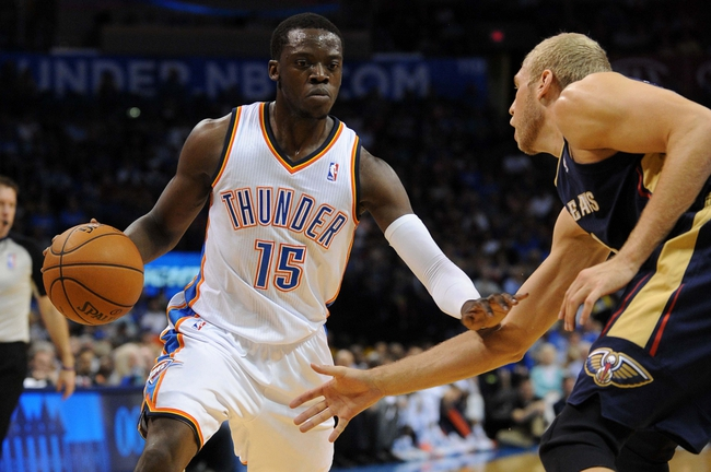 Apr 11, 2014; Oklahoma City, OK, USA;  Oklahoma City Thunder guard Reggie Jackson (15) drives to the basket against New Orleans Pelicans center Greg Stiemsma (34) during the second quarter at Chesapeake Energy Arena. Mandatory Credit: Mark D. Smith-USA TODAY Sports