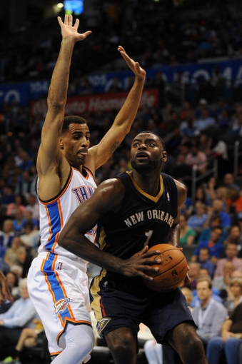 Apr 11, 2014; Oklahoma City, OK, USA;  New Orleans Pelicans forward Tyreke Evans (1) drives to the basket against Oklahoma City Thunder guard Thabo Sefolosha (25) during the third quarter at Chesapeake Energy Arena. Mandatory Credit: Mark D. Smith-USA TODAY Sports