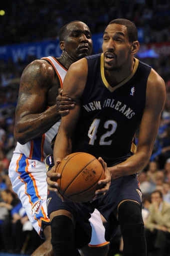 Apr 11, 2014; Oklahoma City, OK, USA;  New Orleans Pelicans center Alexis Ajinca (42) drives to the basket against Oklahoma City Thunder center Kendrick Perkins (5) during the third quarter at Chesapeake Energy Arena. Mandatory Credit: Mark D. Smith-USA TODAY Sports