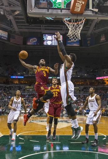 Apr 11, 2014; Milwaukee, WI, USA; Cleveland Cavaliers guard Dion Waiters (3) drives for the basket as Milwaukee Bucks forward Jeff Adrien (12) defends during the third quarter at BMO Harris Bradley Center. Mandatory Credit: Jeff Hanisch-USA TODAY Sports