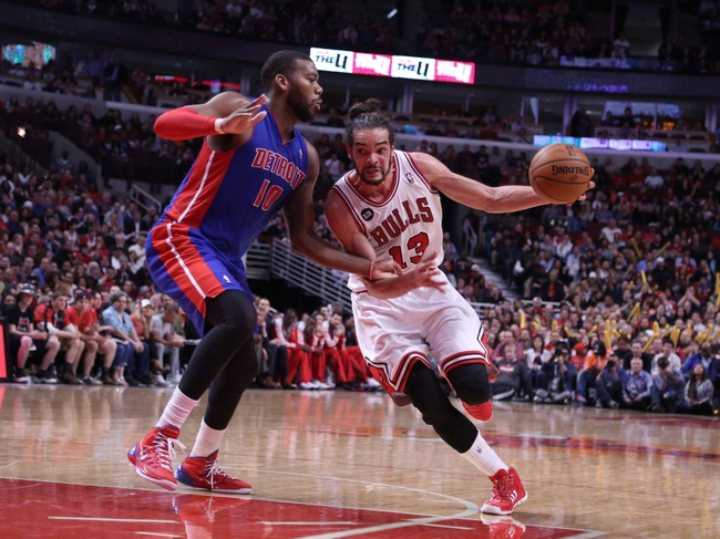 Apr 11, 2014; Chicago, IL, USA; Chicago Bulls center Joakim Noah (13) drives against Detroit Pistons forward Greg Monroe (10) during the second half at the United Center. Chicago won 106-98. Mandatory Credit: Dennis Wierzbicki-USA TODAY Sports