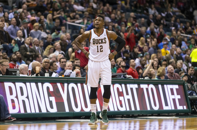 Apr 11, 2014; Milwaukee, WI, USA; Milwaukee Bucks forward Jeff Adrien (12) reacts after being called for a foul during the third quarter against the Cleveland Cavaliers at BMO Harris Bradley Center. Mandatory Credit: Jeff Hanisch-USA TODAY Sports