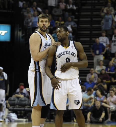 Apr 11, 2014; Memphis, TN, USA; Memphis Grizzlies center Marc Gasol (33) and Memphis Grizzlies guard Tony Allen (9) during the game against the Philadelphia 76ers at FedExForum. Memphis Grizzlies beat Philadelphia 76ers 117 - 95. Mandatory Credit: Justin Ford-USA TODAY Sports