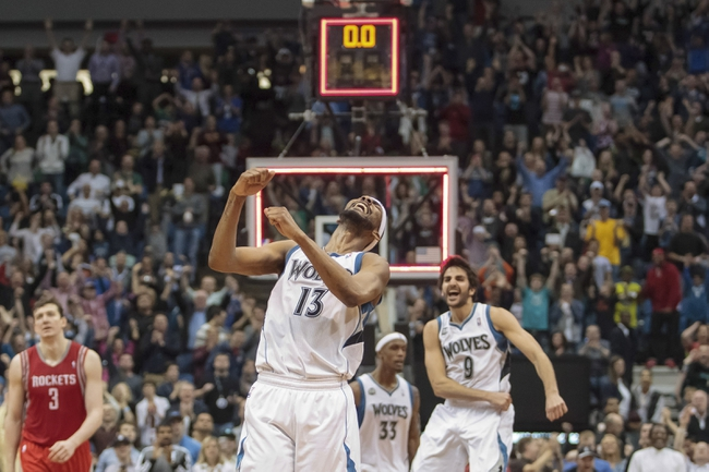Apr 11, 2014; Minneapolis, MN, USA; Minnesota Timberwolves forward Corey Brewer (13) celebrates scoring 51 points at the end of the game against Houston Rockets at Target Center. The Minnesota Timberwolves win 112-110. Mandatory Credit: Brad Rempel-USA TODAY Sports