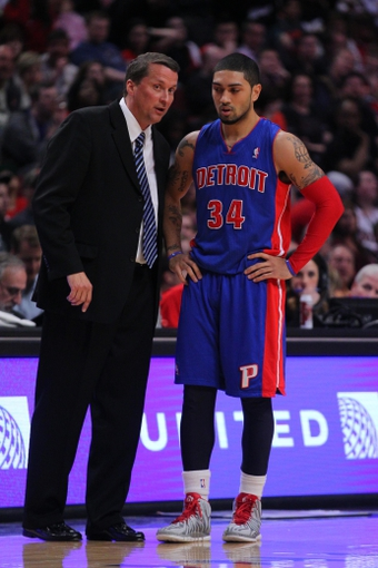 Apr 11, 2014; Chicago, IL, USA; Detroit Pistons head coach John Loyer talks with guard Peyton Siva (34) during the second half against the Chicago Bulls at the United Center. Chicago won 106-98. Mandatory Credit: Dennis Wierzbicki-USA TODAY Sports