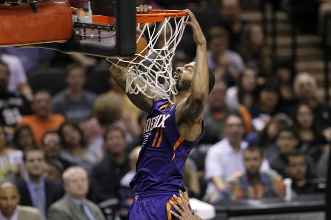 Apr 11, 2014; San Antonio, TX, USA; Phoenix Suns  forward Markieff Morris (11) dunks the ball during the second half against the San Antonio Spurs at AT&T Center. The Spurs won 112-104. Mandatory Credit: Soobum Im-USA TODAY Sports