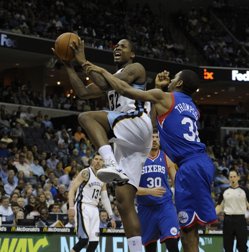 Apr 11, 2014; Memphis, TN, USA; Memphis Grizzlies forward Ed Davis (32) is fouled by Philadelphia 76ers guard Hollis Thompson (31) during the game at FedExForum. Memphis Grizzlies beat Philadelphia 76ers 117 - 95. Mandatory Credit: Justin Ford-USA TODAY Sports