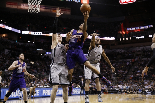 Apr 11, 2014; San Antonio, TX, USA; Phoenix Suns  guard Gerald Green (14) shoots the ball as San Antonio Spurs forward Tiago Splitter (22) defends during the second half at AT&T Center. The Spurs won 112-104. Mandatory Credit: Soobum Im-USA TODAY Sports