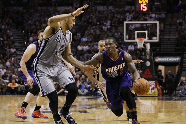 Apr 11, 2014; San Antonio, TX, USA; Phoenix Suns  guard Eric Bledsoe (2) drives to the basket as San Antonio Spurs forward Jeff Ayres (11) defends during the second half at AT&T Center. The Spurs won 112-104. Mandatory Credit: Soobum Im-USA TODAY Sports