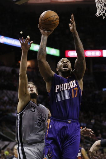 Apr 11, 2014; San Antonio, TX, USA; Phoenix Suns forward P.J Tucker (17) shoots the ball past San Antonio Spurs forward Marco Belinelli (3) during the second half at AT&T Center. The Spurs won 112-104. Mandatory Credit: Soobum Im-USA TODAY Sports
