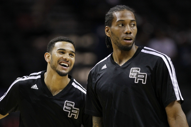 Apr 11, 2014; San Antonio, TX, USA; San Antonio Spurs forward Kawhi Leonard (right) and guard Cory Joseph (left) warm up before the game against the Phoenix Suns at AT&T Center. Mandatory Credit: Soobum Im-USA TODAY Sports
